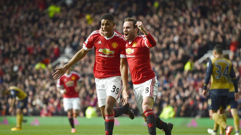 MANCHESTER, ENGLAND - FEBRUARY 28: Marcus Rashford of Manchester United celebrates scoring his opening goal with Juan Mata (R) during the Barclays Premier