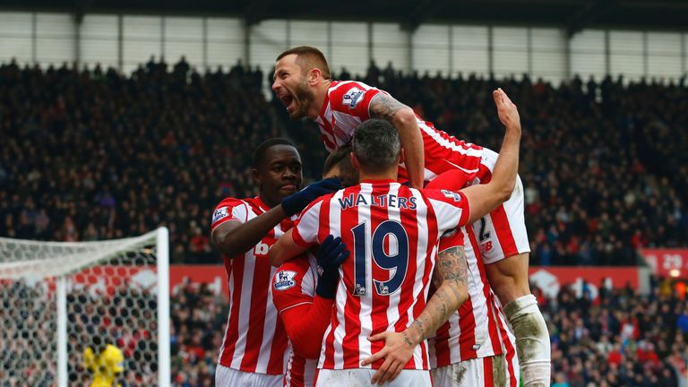 Stoke City's striker Marko Arnautovic (C) celebrates with teammates after scoring his second goal during the match against Aston Villa