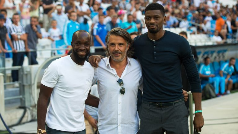 Olympique de Marseille's French president Vincent Labrune (C) poses with Lassana Diarra (L) and Abou Diaby