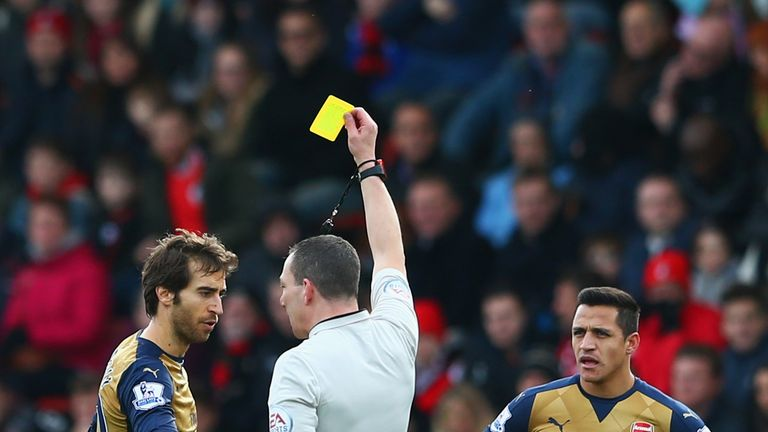 BOURNEMOUTH, ENGLAND - FEBRUARY 07:  Mathieu Flamini of Arsenal is shown a yellow card by referee Kevin Friend during the Barclays Premier League match bet