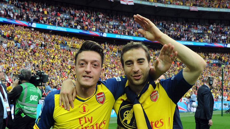 LONDON, ENGLAND - MAY 30: (L-R) Arsenal's Mesut Ozil and Mathieu Flamini celebrate after the FA Cup Final between Aston Villa and Arsenal