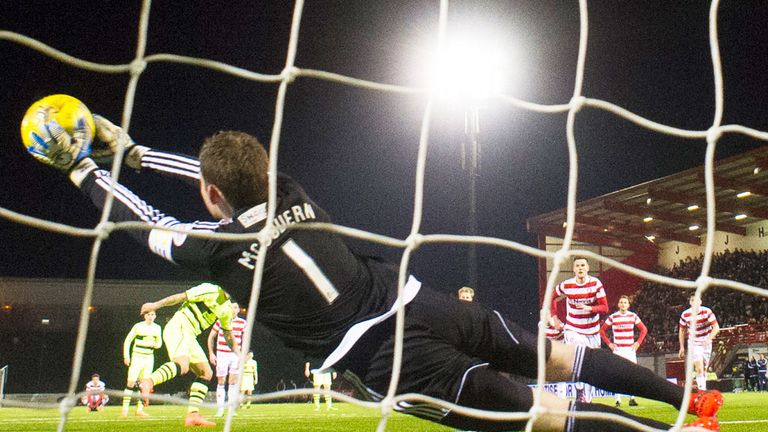 Hamilton goalkeeper Michael McGovern saves a penalty from Celtic striker Leigh Griffiths