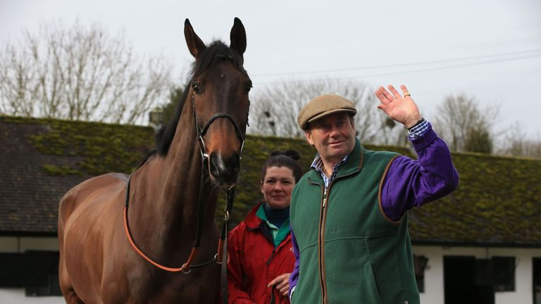 Trainer Nicky Henderson proudly stands with My Tent or Yours