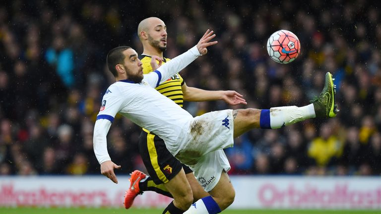 Giuseppe Bellusci of Leeds and Nordin Amrabat of Watford compete for the ball