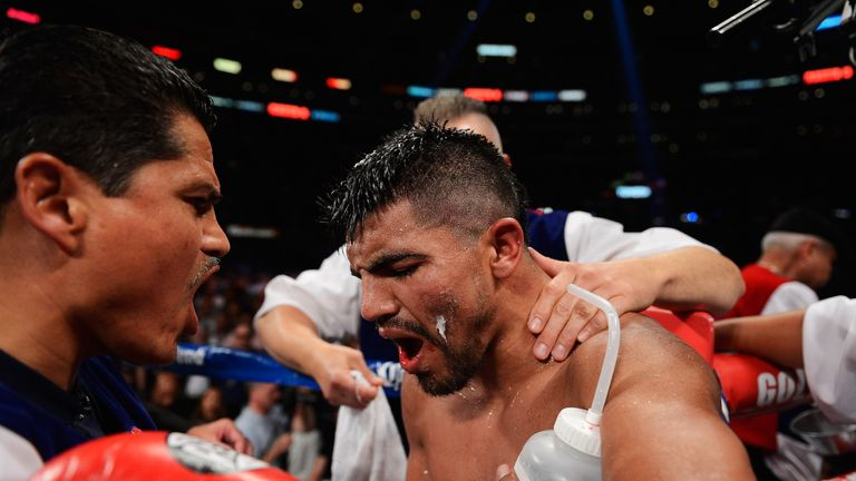 Victor Ortiz at the end of the ninth after having his jaw broken by Josesito Lopez