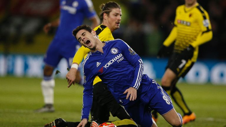 Chelsea's Oscar (front) is fouled by Watford's Sebastian Prodl (back)