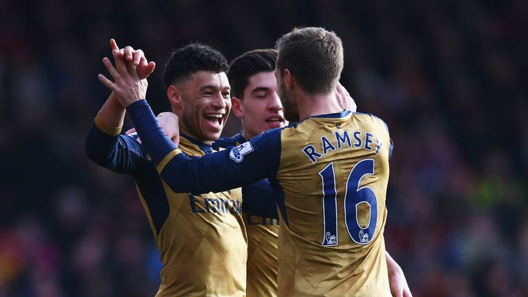 BOURNEMOUTH, ENGLAND - FEBRUARY 07:  Alex Oxlade-Chamberlain of Arsenal (L) celebrates with Hector Bellerin and Aaron Ramsey as he scores their second goal
