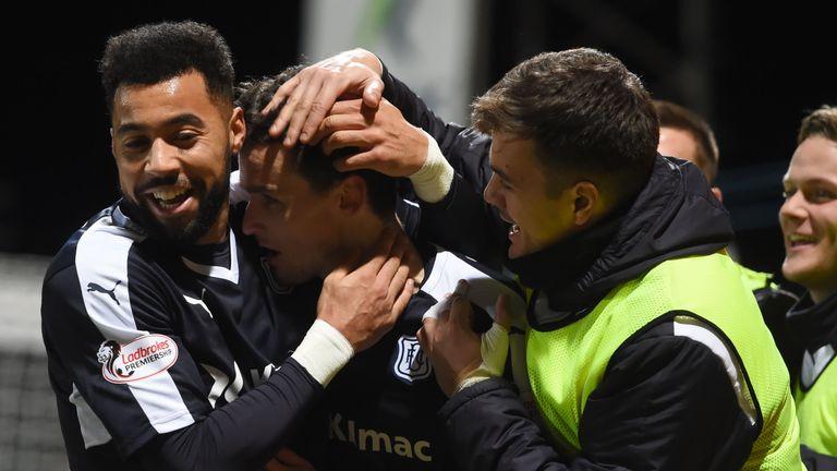 Dundee's Paul McGinn (centre) celebrates with Kane Hemmings (left) having opened the scoring