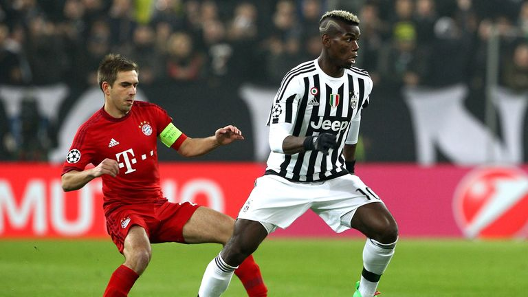 Paul Pogba (R) of Juventus competes for the ball with Philipp Lahm