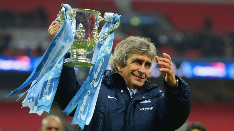 LONDON, ENGLAND - MARCH 02:  Manuel Pellegrini, manager of Manchester City celebrates victory with the trophy after the Capital One Cup Final between Manch