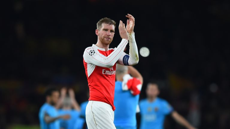LONDON, ENGLAND - FEBRUARY 23:  A dejected Per Mertesacker of Arsenal applauds the home fans following their team's 2-0 defeat during the UEFA Champions Le