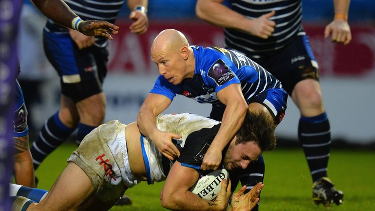Peter Stringer (making tackle) will spend another year at Sale