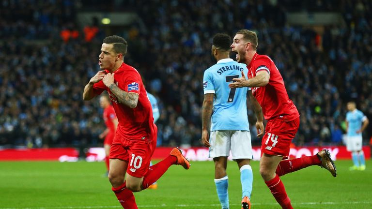 LONDON, ENGLAND - FEBRUARY 28:  Philippe Coutinho of Liverpool (10) celebrates with Jordan Henderson (14)