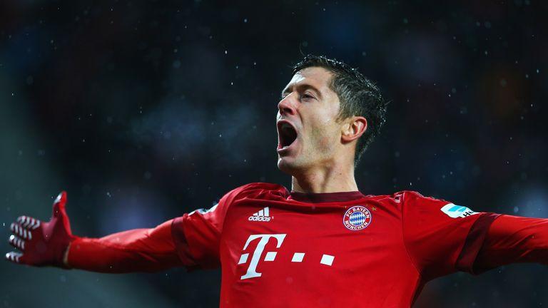 AUGSBURG, GERMANY - FEBRUARY 14:  Robert Lewandowski of Bayern Munich celebrates as he scores
