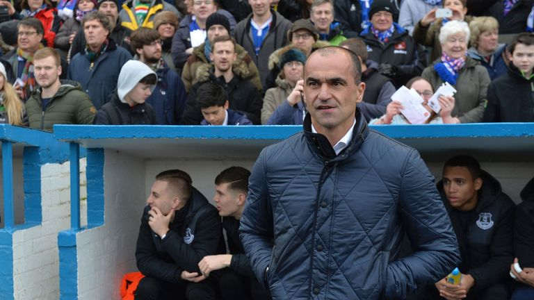 Everton's Spanish manager Roberto Martinez arrives for the English FA Cup fourth round football match between