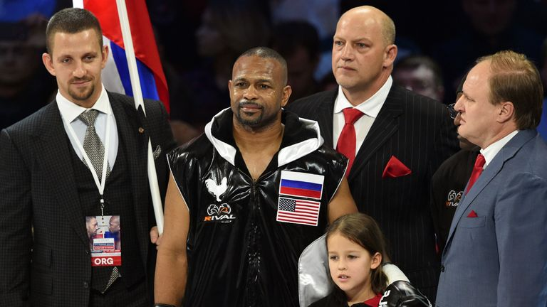American-Russian boxer Roy Jones Jr. (2nd L) listens to the Russian anthem