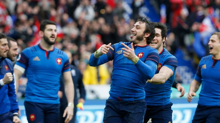 France full-back Maxime Medard (C) celebrates after scoring a try against Ireland