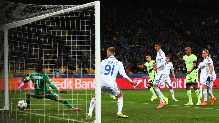 KIEV, UKRAINE - FEBRUARY 24:  Sergio Aguero #10 of Manchester City scores the opening goal past goalkeeper Oleksandr Shovkovskiy of Dynamo Kiev