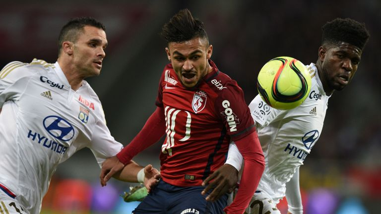 Lille midfielder Sofiane Boufal (centre) vies with Lyon defender Samuel Umtiti (right) and Jeremy Morel.