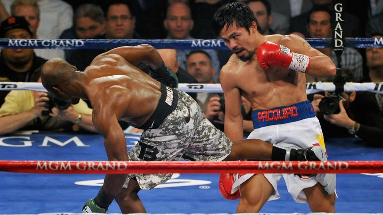 Timothy Bradley (L) and Manny Pacquiao battle it out during their WBO world welterweight championship boxing match at the MGM Gr