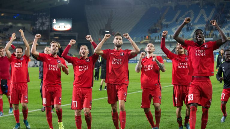 Midtjylland's players celebrate after winning the UEFA Europa League group D football match against Club Brugge on October 1, 2015 in Brugge
