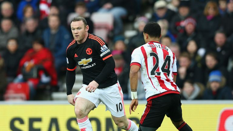 Wayne Rooney of Manchester United controls the ball under pressure of DeAndre Yedlin of Sunderland