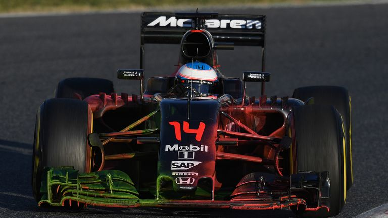 Alonso's car was covered in aero paint for his late run