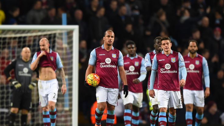 Gabby Agbonlahor and Ashley Westwood of Aston Villa show their frustration after Everton's third goal