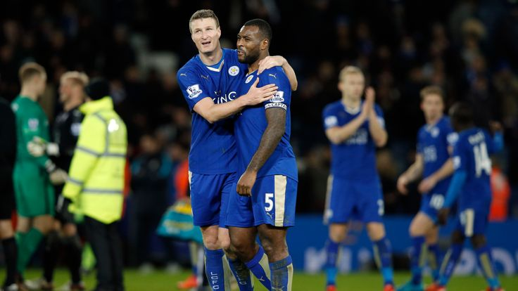 Leicester City's defender Robert Huth and Wes Morgan embrace