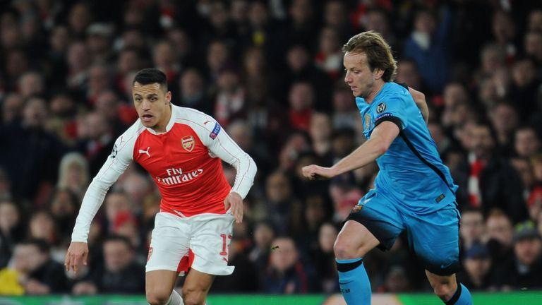 Alexis Sanchez of Arsenal breaks past Ivan Rakitic of Barcelona