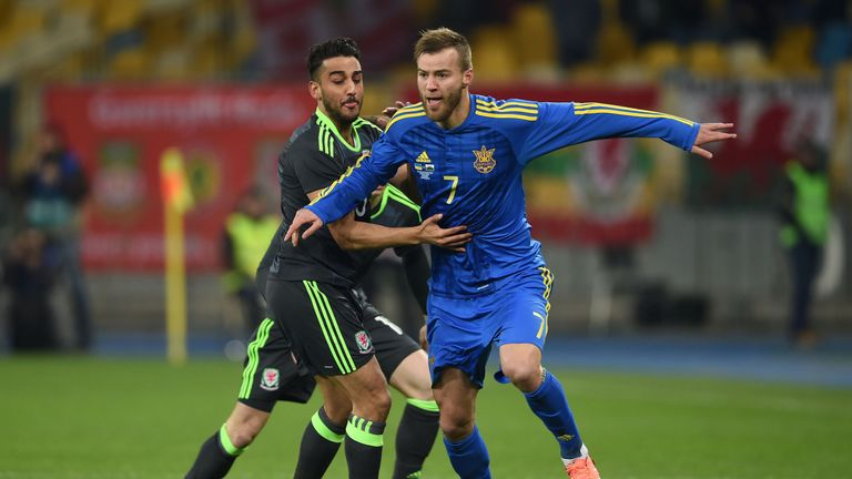 Yarmolenko and Wales' Neil Taylor (l) battle for the ball