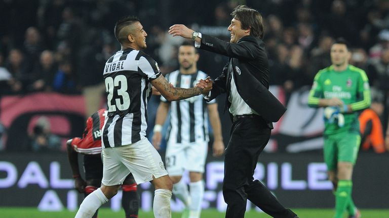 TURIN, ITALY - APRIL 21:  Juventus FC head coach Antonio Conte (R) and Arturo Vidal celebrate victory at the end of the Serie A match Juventus FC v AC Mila