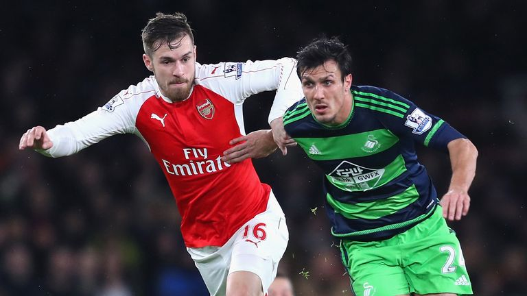 Jack Cork (right) and Aaron Ramsey l challenge for the ball