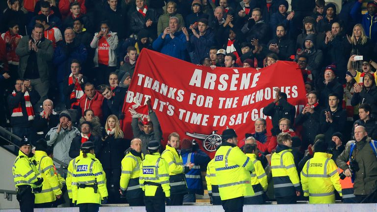 A banner calling for Arsene Wenger to go is held up during Arsenal's FA Cup win at Hull