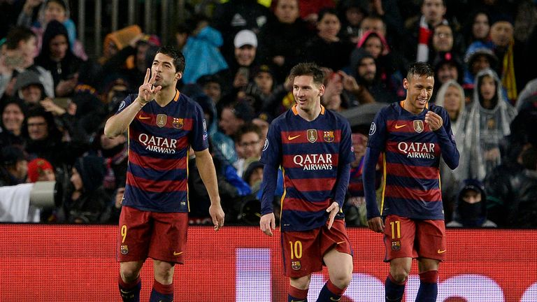 Luis Suarez celebrates Lionel Messi and Neymar