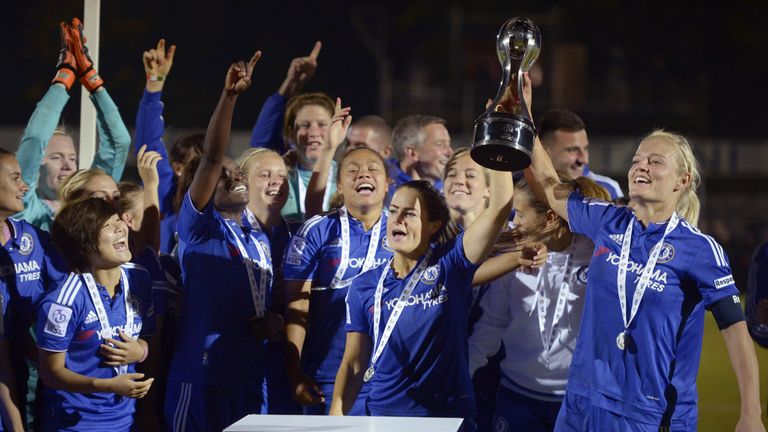 Chelsea captain Katie Chapman (right) and team-mates with the FA WSL trophy after the match against Sunderland Ladies