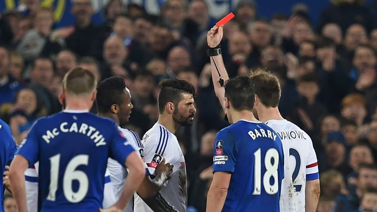 Chelsea's Brazilian-born Spanish striker Diego Costa (C) is shown a red card by referee Michael Oliver during the English