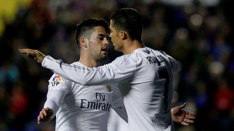 Real Madrid's midfielder Isco (L) celebrates a goal with Cristiano Ronaldo