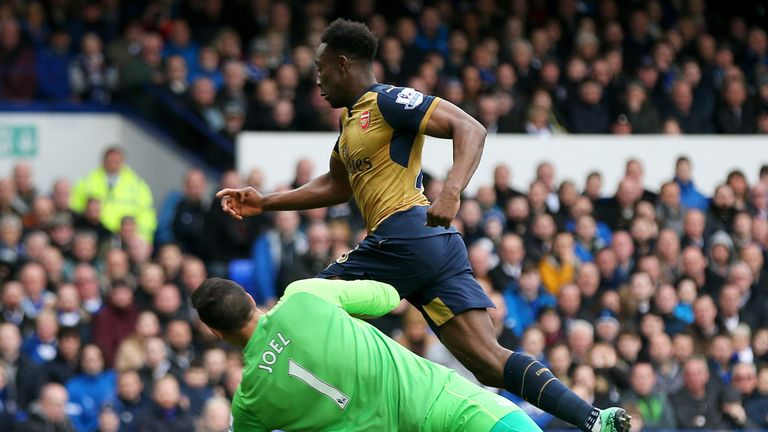 Danny Welbeck rounds Joel Robles before scoring Arsenal's opening goal