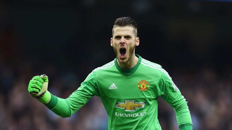 MANCHESTER, ENGLAND - MARCH 20:  David De Gea of Manchester United celebrates as Marcus Rashford of Manchester United scores their first goal during the Ba