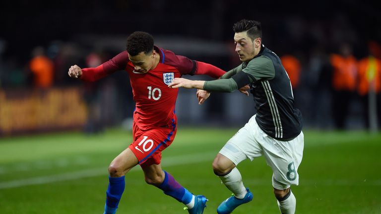 BERLIN, GERMANY - MARCH 26:  Dele Alli of England and Mesut Oezil of Germany compete for the ball during the International Friendly match between Germany a