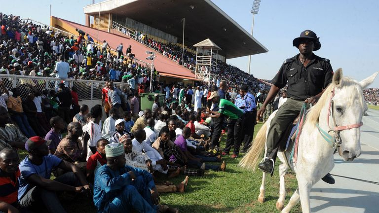 A policeman rides a horse as he patrols during the African Cup of Nations qualification match between Egypt and Nigeria