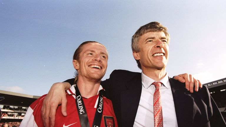 Emmanuel Petit and Arsene Wenger celebrate winning the Premier League title in May 1998