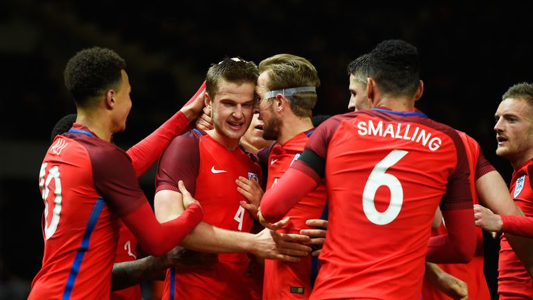 Eric Dier (2nd L) of England celebrates scoring his team's third goal