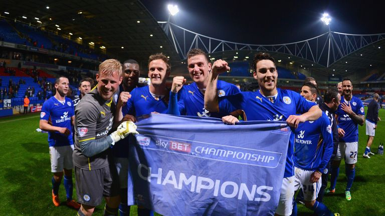Kasper Schmeichel, Andy King, Chris Wood and Matty James of Leicester City celebrate winning the Championship