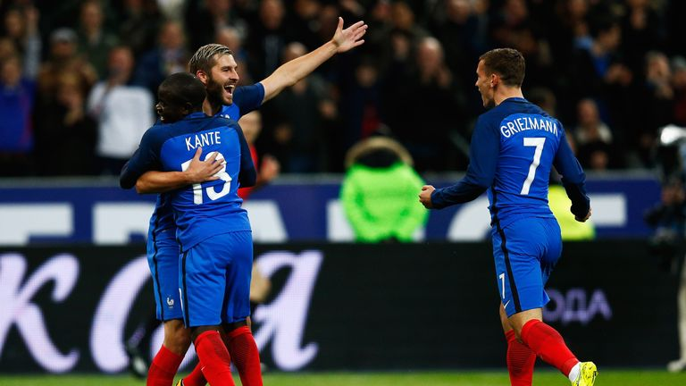 N'Golo Kante celebrates with teammates, Andre-Pierre Gignac and Antoine Griezm, after scoring France's first goal in a 4-2 win over Russia in Paris