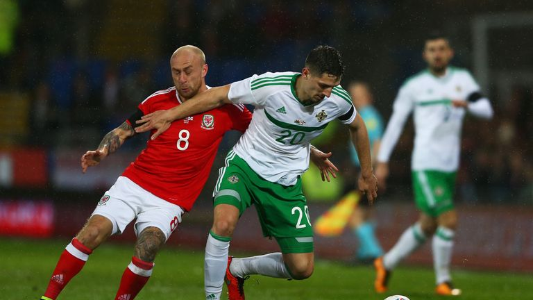 Craig Cathcart of Northern Ireland holds off  David Cotterill of Wales during the international friendly