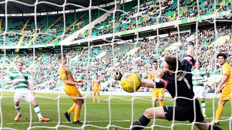 Gary Mackay-Steven (l) scores for Celtic in the victory over Morton
