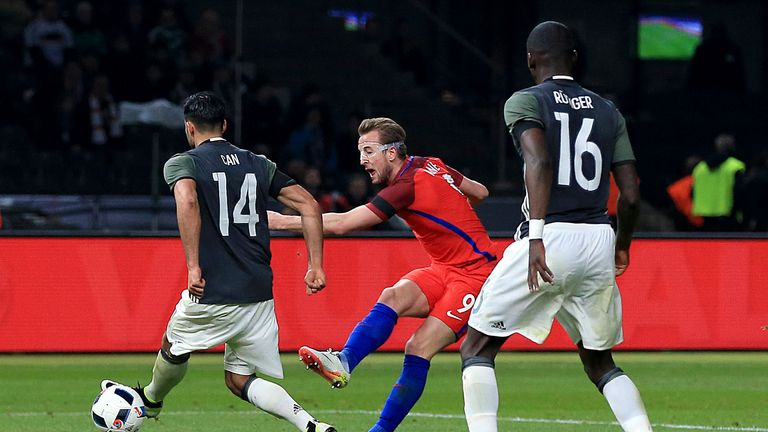 England's Harry Kane (centre) scores their first goal of the game during the International Friendly match at the Olympic Stadium, Berlin