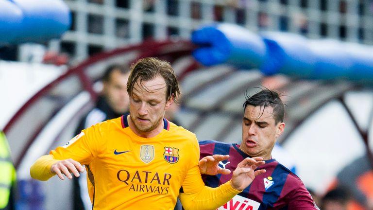 Ivan Rakitic of FC Barcelona duels for the ball with Daniel Garcia of SD Eibar
